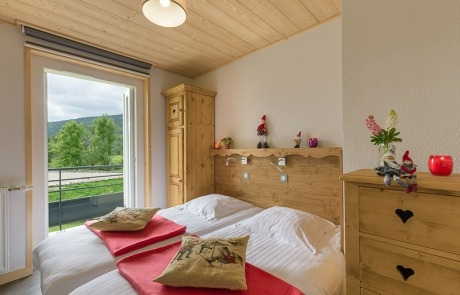 Twin beds room N° 14 and 24 with French window on balcony Residence Les Tavaillons